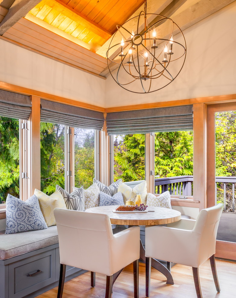 morning room designs chairs table bench pillows big windows railing chandelier transitional design