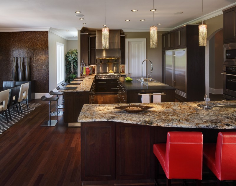 mosaic tiled wall ice brown granite coutertop brown cabinet contemporary island pendant light red chairs