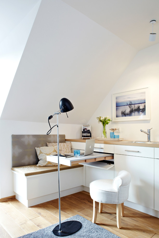 multifunctional furniture in a contemporary living room with standing lamp corner workspace a cute white comfy chair