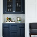 navy blue kictchen cabinets shingle panels dark wood floor