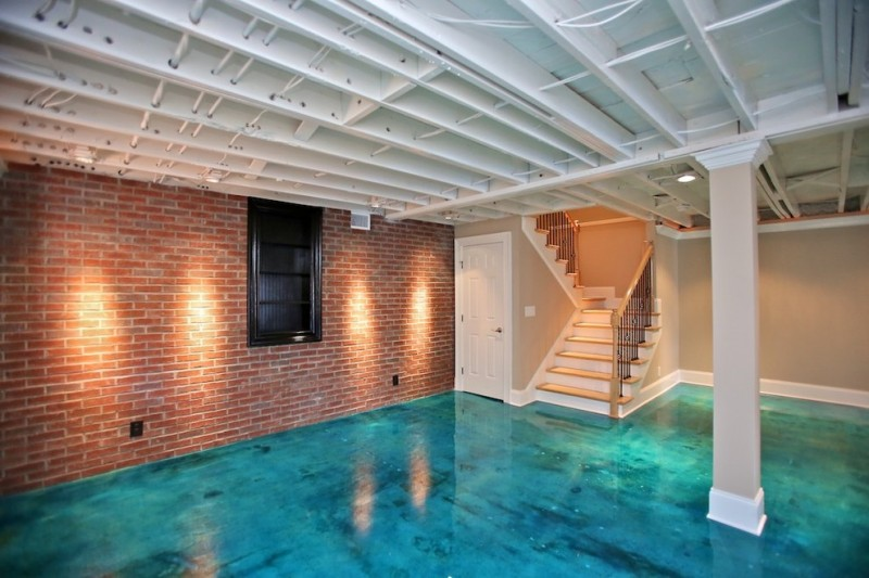 nicely designed basement floors concrete floor brick wall stairs pillars window door lighting