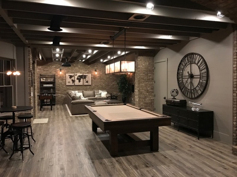 nicely designed basement floors medium tone hardwood floor hanging lamps clock storage item stools table sofa pillow billiard area