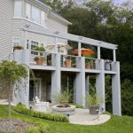 outdoor metal railing with flower design idea chairs big pots flowers pillars windows