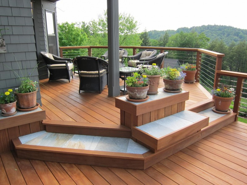 outdoor metal railing with flower design ideas seating table wood floor flowers pots glass