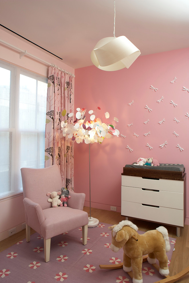 pink painted walls idea with white paper dragonflies ornaments cozy pink armchair purple area rug with flower motifs animal rocking chair unique standing lamp