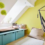 Pop Yellow And White Wall Combination With Green Flowers Prints Large Size Skylight Full Length Table Bench In Blue Pale Toned Wood Floorboards
