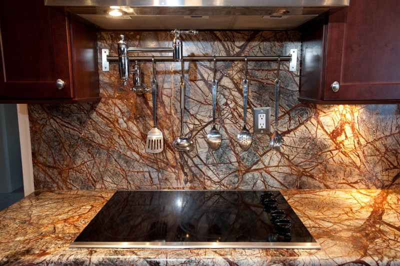 rainforest brown granite countertop brown granite backsplash stainless steel appliances brown wood cabinet