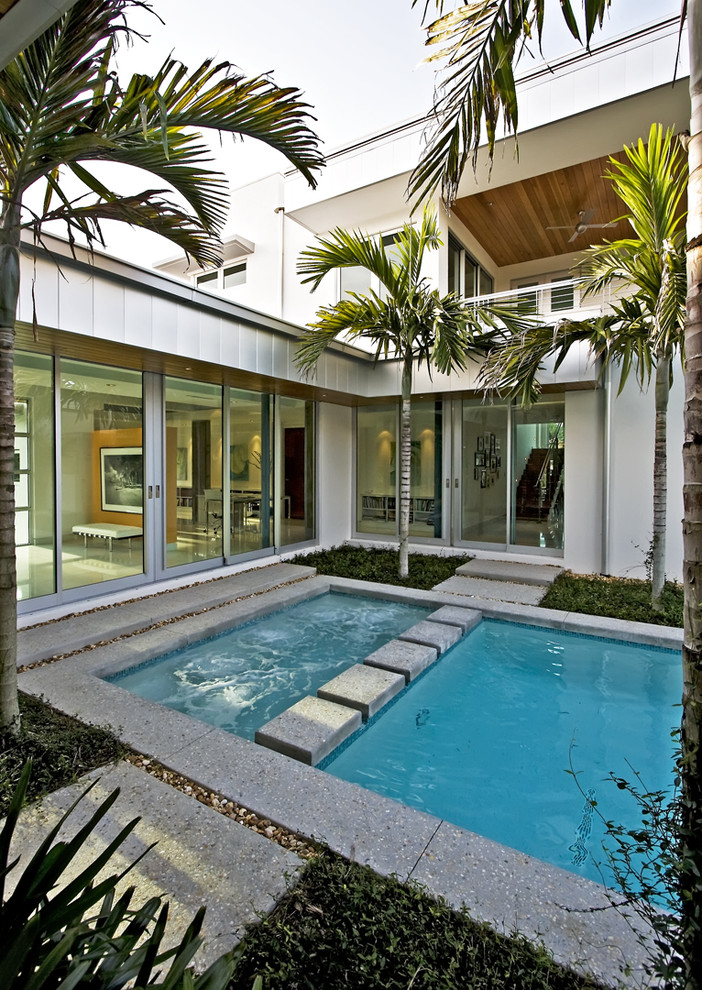 rectangular pool jacuzzi area lap swimming granite walkway granite sides mirror windows