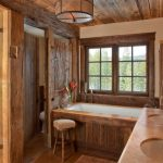 rustic mud wood interior bathroom soaking tub stool window wall lamps shower toilet faucets