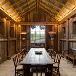 rustic mud wood interior dining room lighting lights table chairs windows logs bench