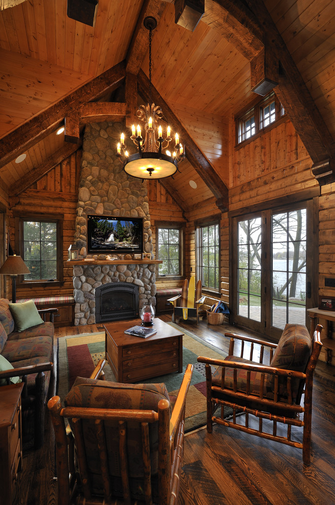 rustic mud wood interior living room wall tv fireplace chandelier chairs windows door pillows table