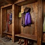 rustic mud wood interior mudroom stone floor painting clothes racks entry room