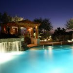 Rustic Yard With Pool With Fountain, Wooden Pergolla, White Lighting From The Pool, Plants, Pergolla