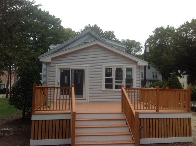 simple and small cottage exterior with wood deck wood exterior stairs wood railing system and wood vertical way installation deck skirt idea