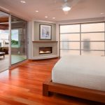 Simple Glass Door For Bedroom Bed Pillows Wood Floor Ceiling Fan Lights Fireplace Painting Contemporary Room
