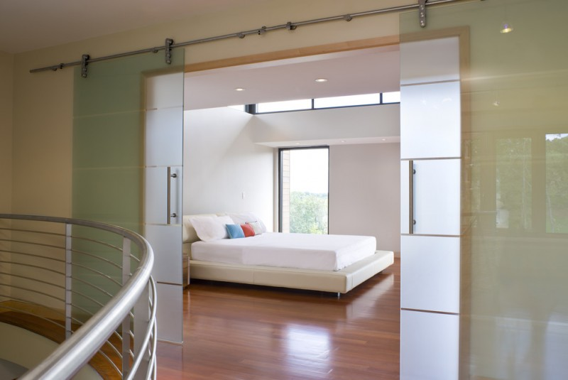simple glass door for bedroom railing wood floor sliding doors handles bed pillows window ceiling lamps