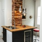Small Bar With Stone Block Arranged In A Post, Modern Silver Pendants, Dark Cabinet With Brown Wooden Counter Top, Silver Sink