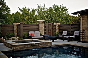 small rectangular pool rectangular fountain contemporary sofas and table with wooden fences. jpg