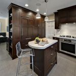 small single high table in white marble counter top, brown wooden cabinet under the top