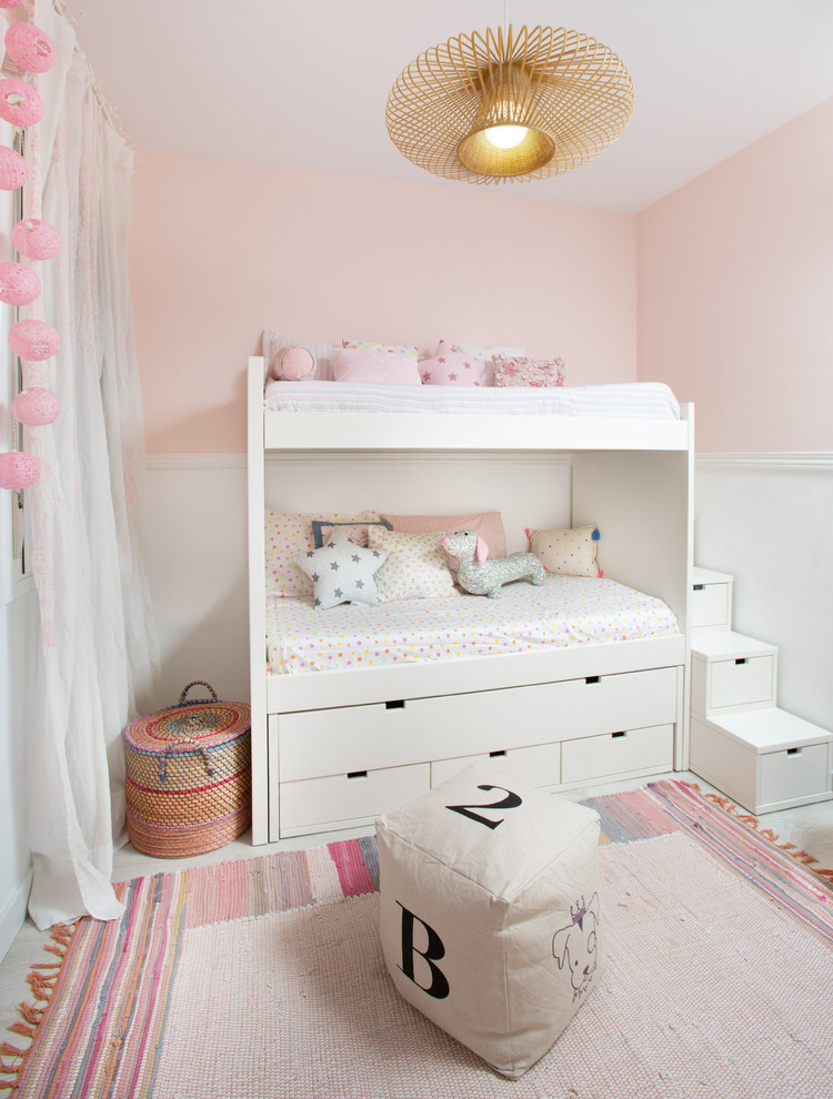 soft pink white wall painting in halfway application white bunk bed with under storage and stairs traditional area rug in colorful tones gold accented ceiling lamp