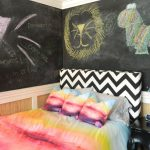 stylish bedroom design with kids colorful item blackboard table letters pillows drawings eclectic room