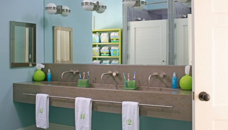 three bathroom marble sink with silver metal faucet, long towel rack divided into three parts