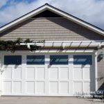 tiled bronze siding square window plain window garage white garage door greenery
