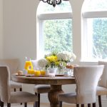 traditional dining room bright colour schemes carpet chairs table flowers window beige white brown