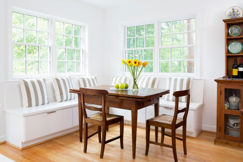 traditional dining room bright colour schemes hardwood floor windows bench pillows cabinet shelves chairs table flowers
