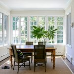traditional dining room bright colour schemes windows carpet wood floor chairs table white walls sandals