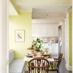 traditional dining room bright colour schemes wood floor chairs table bench wall cabinets painting light green walls white