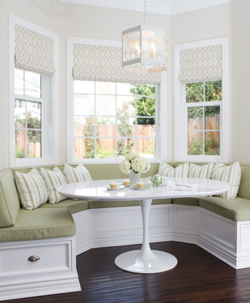 traditional dining room bright colour schemes wood floor table flowers bench pillows big windows beige white light green