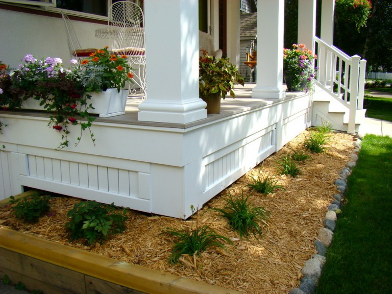 traditional front porch with white painted wood house skirting idea