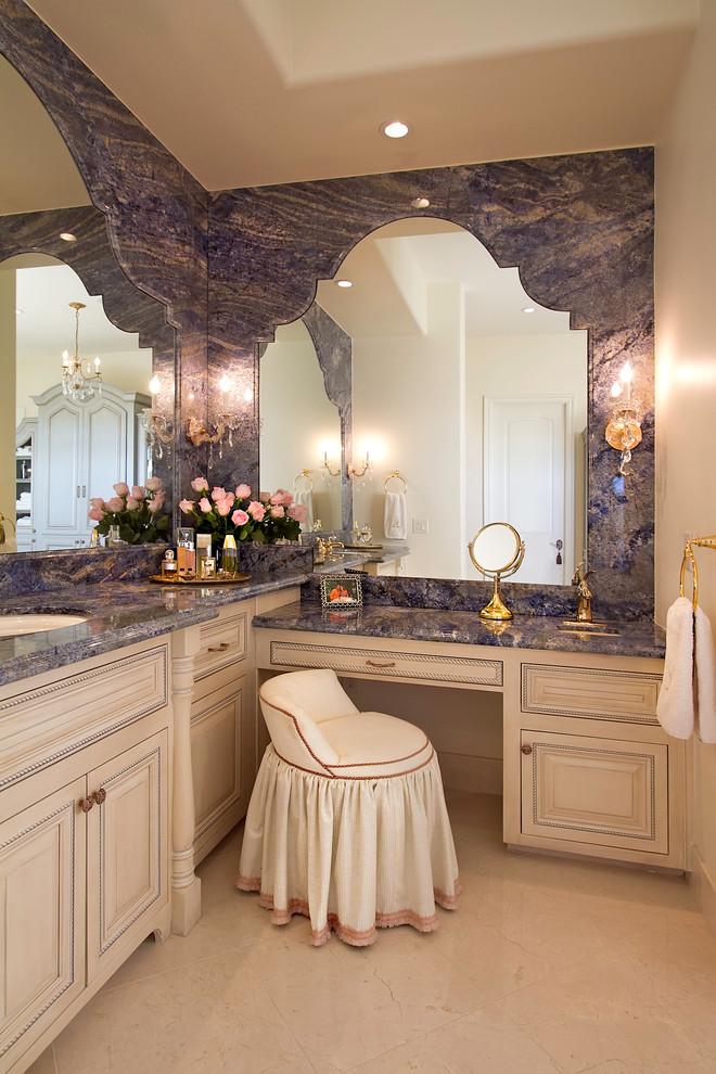 traditional vanity with L shaped counter top in granite that continues to the mirror frame, white cabinet