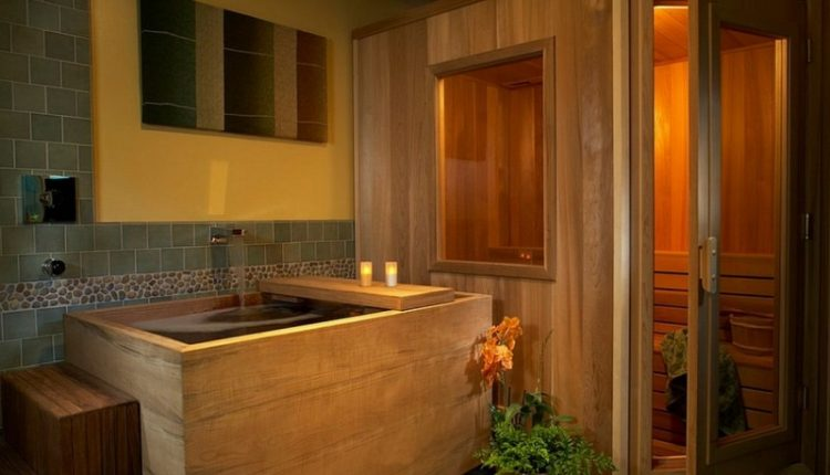 traditional wooden japanese soaking tub with showers