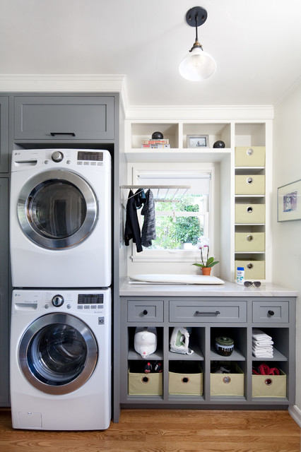 transitional laundry room with cubies utility cabinets