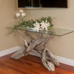 Tree Branch Table With Glass Surface Light Beige Walls Medium Toned Wood Floors