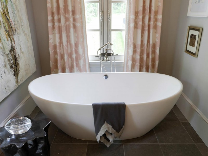 unique and luxurious porcelain Japanese tub and free standing faucet