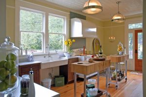 unique small kitchen island ideas wood floor window two islands cabinets hanging lamps chandelier trashbin traditional room