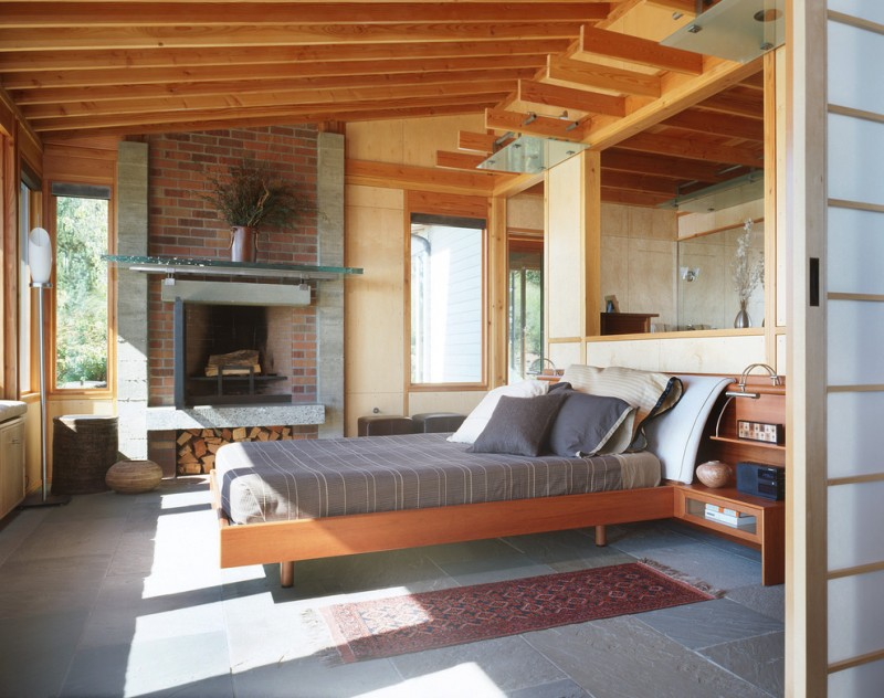urban style wood bed design with cozy headboard grey soapstone floors standard fireplace with red bricks surrounding logs roof soft creame walls glass windows with wood frames