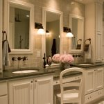 Vanity With Green Granite Top, Two Sinks With Makeup Area In The Middle, White Tile In The Wall, Porcelain Tile Flooring, White Cabinet, White Chair,