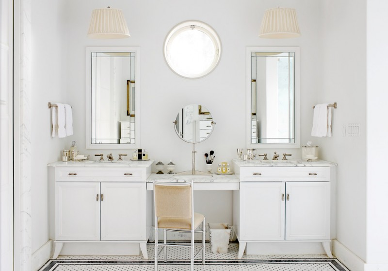 vanity with white granite countertop with two sink on both ends, makeup area in the middle, white wooden cabinet, two square mirrors, round make up mirror