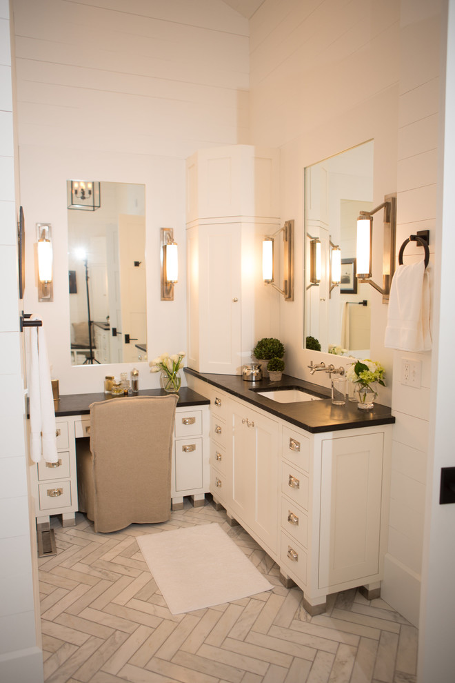 Elegant White Bathroom With White Wall, Cabinetery, Black Soapstone Top, Tile  Flooring, Mirror. Traditional Bathroom With L Shaped Vanity ...