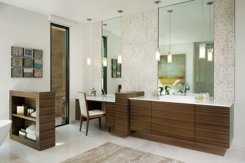 white countertop vanity with zebra cabinet, mosaic tile on the wall, long glass pendants, clear makeup area with white chair