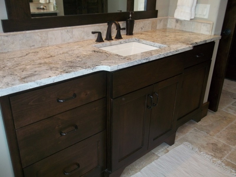 white granite bathroom dark faucet undermount white sink wooden cabinet