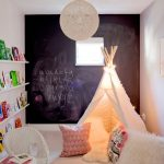 White Wall Paint With Chalkboard Decoration Open Shelves In White Rattan Chair In White Small White Table Cool Tent In Soft Beige Some Accent Pillows And Fluffy White Blanket