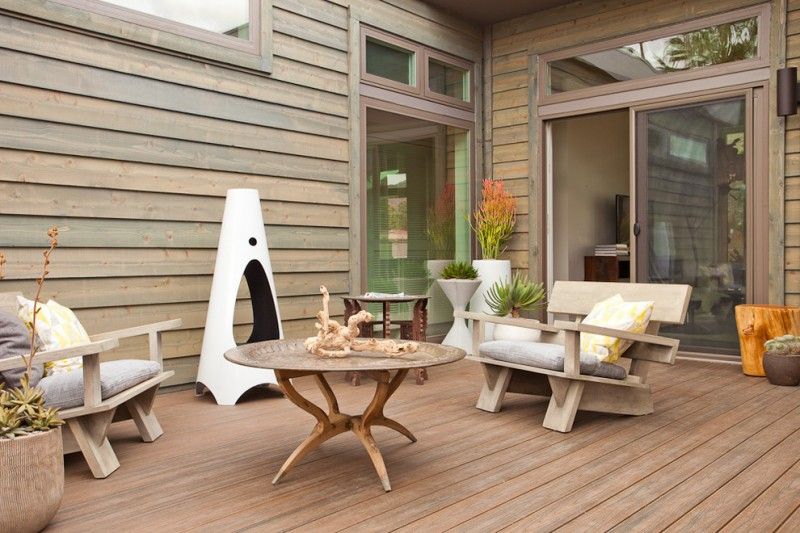 wood deck furniture made of white pine wood siding floors wood siding walls glass windows and door with wood frames