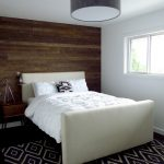 wood horizontal paneled wall in one side of a bedroom's wall
