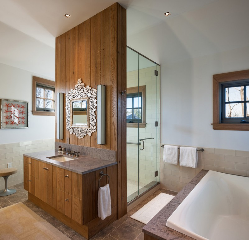 wood vertical paneled wall in bathroom for mirror and sink
