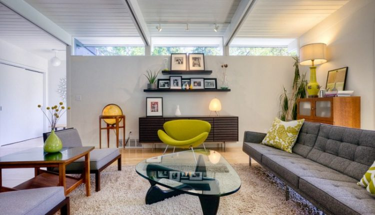 Green orange slice chair hardwood floors green apple hued lamp vintage armchairs side table illuminated globe coffe table cream rug living room cabinet